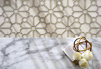 Jardin, a stone waterjet mosaic, shown in honed Bianco Antico, polished Calacatta, and Raw Fiber glass. Designed by Sara Baldwin Designs for New Ravenna.<br />