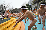 January 8, 2017, Tokyo, Japan - Under the cloudy sky half-naked men warm themselves up before dipping into icy cold water during a new years annual rite in downtown Tokyo on a cold Sunday of January 8, 2017. In Japan, practitioners of Shinto, a Japanese ethnic religion focusing on ritual practices to be carried out diligently, immerse themselves in icy water under the frigid temperatures in the purification ritual, believed to cleanse the spirit or just to show off their bravery and endurance. (Photo by Natsuki Sakai/AFLO) AYF -mis-