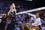 10 September 2015: Stanford's Hayley Hodson (3) and Merete Lutz (17) block a shot by North Carolina's Taylor Treacy (20). The University of North Carolina Tar Heels hosted the Stanford University Cardinal at Carmichael Arena in Chapel Hill, NC in a 2015 NCAA Division I Women's Volleyball contest. North Carolina won the match 25-17, 27-25, 25-22.