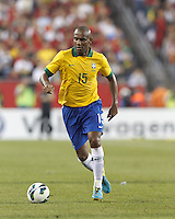 Brazil defender Maicon (15) dribbles.  In an international friendly, Brazil (yellow/blue) defeated Portugal (red), 3-1, at Gillette Stadium on September 10, 2013.