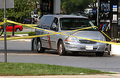 Aspen Hill, MD - October 3, 2002 -- A van operated by one of the victims of the random shootings at the Aspen Hill Mobil where 54-year-old part-time taxi driver Premkumar Walekar was shot and killed this morning, 3 October, 2002 in Aspen Hill, MD.  A blood stain from one of the victims is clearly visible on the side of the car.<br /> Credit: Ron Sachs / CNP<br /> <br /> (RESTRICTION: NO New York or New Jersey Newspapers or newspapers within a 75 mile radius of New York City)