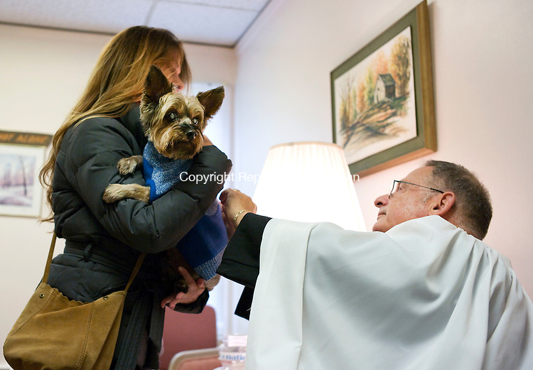 Middlebury, CT- 03 October 2015-100315CM03-  Melissa Marley of Middlebury has Nardi, her 14 year old Silky Terrier is blessed by The Reverend Andrew Zeman at St. George's Episcopal Church in Middlebury on Saturday.     Christopher Massa Republican-American