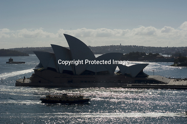 Sydney Opera House, and a ferry, in early morning light.