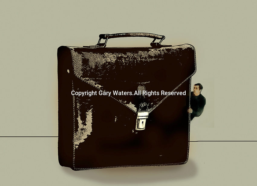 Man peeping out from behind briefcase