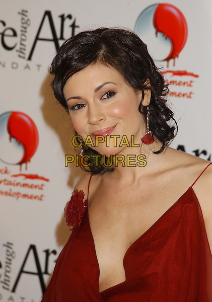 ALYSSA MILANO.The 2nd Annual 'Red Party' to Benefit The Life Through Art Foundation held at the Shrine Auditorium. .December 4th, 2004.headshot, portrait, red dangling earrings, spaghetti straps, plunging neckline.www.capitalpictures.com.sales@capitalpictures.com.© Capital Pictures.
