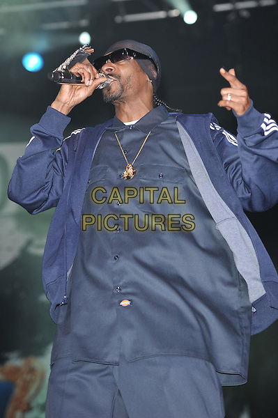 Snoop Dogg (Calvin Cordozar Broadus, Jr.).Live in concert at the O2 Arena, London, England. 7th October 2011.half length music gig performing singing on stage blue adidas tracksuit  hoodie shirt sunglasses microphone name handle .CAP/MAR.© Martin Harris/Capital Pictures.