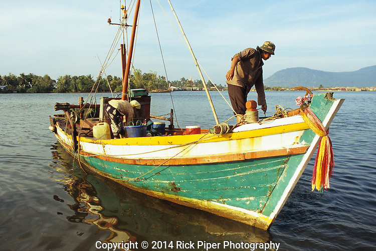 Cham fishing boat at dawn on the Sanke river, Kampot, Cambodia.
