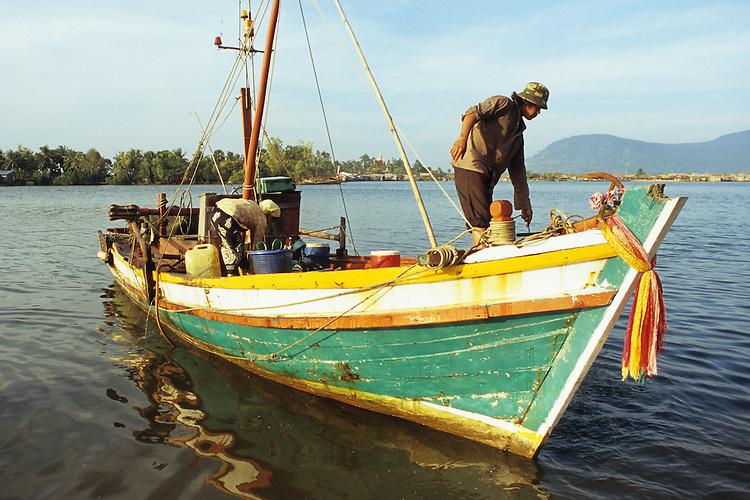 Cham fishing boat at dawn on the Sanke river, Kampot, Cambodia.