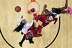 COLUMBUS, OH - MARCH 30: Jonika Garvin #21 and Teaira McCowan #15 of the Mississippi State Bulldogs fight for a rebound against Jazmine Jones #23 and Sam Fuehring #3 of the Louisville Cardinals  during a semifinal game of the 2018 NCAA Division I Women's Basketball Final Four at Nationwide Arena in Columbus, Ohio. (Photo by Ben Solomon/NCAA Photos via Getty Images)