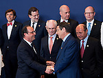 Brussels, Belgium -- July 16, 2014 -- European Council, EU-summit, meeting of Heads of State / Government to decide on the agenda and the composition of the new EU-Commission; here, prior to family photo: Francois (François) HOLLANDE (le), President of France, shakes hands with Nicos ANASTASIADES (ri), President of Cyprus; behind, le-ri, 1-6: 1- Elio DI RUPO, Prime Minister of Belgium; 2- Mariano RAJOY BREY, Prime Minister of Spain; 3- Herman Van ROMPUY, President of the European Council; 4- Fredrik REINFELDT, Prime Minister of Sweden; 5- Traian BASESCU, President of Romania; 6- Bohuslav SOBOTKA, Prime Minister of the Czech Republic -- Photo: © HorstWagner.eu