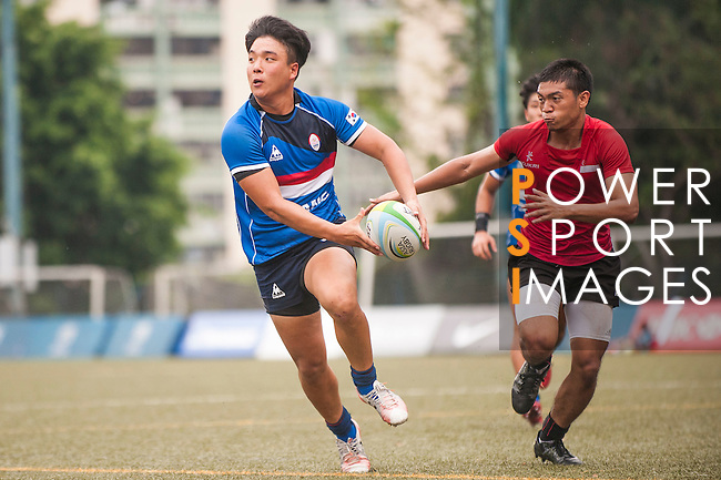 Junhwa Kim (l) of South Korea fights for the ball with Mark Anthony of Singapore during the match between South Korea and Singapore of the Asia Rugby U20 Sevens Series 2016 on 12 August 2016 at the King's Park, in Hong Kong, China. Photo by Marcio Machado / Power Sport Images