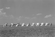 Artist Stanley Marsh's 'Cadillac Ranch' which set a row of old Cadillac cars set in a field alongside a highway in Amarillo, Texas. May 7, 1977.