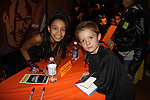Kameron poses with Laurissa Romain (South Pacific), New York City, New York. Photo taken at Kids Night on Broadway at Madame Tussauds, NYC. (Photo by Sue Coflin/Max Photos)
