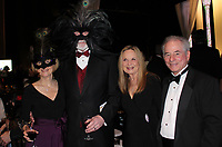 NWA Democrat-Gazette/CARIN SCHOPPMEYER Terry and Mike  Johnson (from left) and Marti and Kelly Sudduth visit at the Masquerade Ball.