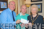 Pat Gill, Darby O'Gills, Killarney, pictured presenting the proceeds of their recent Supper Club in of of the South Kerry Parkinsons Association, to Jack and Grace McCrae, on Tuesday night.