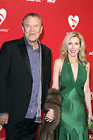 Glen Campbell and Kim Woolen at the 2012 MusiCares Person of the Year Tribute To Paul McCartney  at the Los Angeles Convention Center on February 10, 2012 in Los Angeles, California. <br /> CAP/MPI26<br /> &copy;MPI26/Capital Pictures