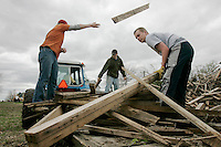 Josh Langhoff (16), Ryan Young (16), and Sam MacDonald (13), all students at Alburnett High School, help clean up a tornado's aftermath in Alburnett on Tuesday, April 28, 2009. A tornado struck the area on Sunday, causing no injuries, but downing large trees and destroying at least three large campers. Two Alburnett High School teachers,  Linda Franck and Vicki Meadows, organized the student clean because many students were affected by the storm. (Chris Mackler/The Gazette).