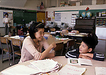 Berkeley CA Chinese collee student volunteer helping 3rd grade Chinese boy adjust to class