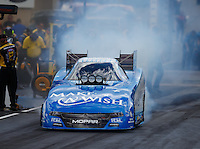 Jul 23, 2016; Morrison, CO, USA; NHRA funny car driver Tommy Johnson Jr during qualifying for the Mile High Nationals at Bandimere Speedway. Mandatory Credit: Mark J. Rebilas-USA TODAY Sports