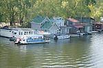 Floating houses on the Mississippi River in Winona Minnesota USA near Old Duke Road Bridge.