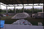 October 11, 2011, Okumamachi, Japan - Some 480,000 used suits, defined as low-level nuclear waste, are piled up high at the radioactive wastes dump at J Village, a temporary quarters for Tokyo Electric Power Co.s workers near the crippled Fukushima No. 1 nuclear power plant in Okumamachi, Fukushima Prefecture, some 210km northeast of Tokyo, on Tuesday, October 11, 2011. Tokyo Electric Power Co., the operator of the Fukushima power plant, has trouble dealing with tons of protective suits used by its workers struggling to bring the runaway reactors under control. The utility known as TEPCO says because of a lack of government policy on how to dispose of the gear, it has no choice but to keep piling them up. The photo was released by the TEPCO in Tokyo on October 15. (Photo by TEPCO/AFLO) [0006] -mis-