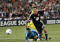 WASHINGTON, DC - AUGUST 4, 2012:  Perry Kitchen (23) of DC United clashes with Andy Gruenebaum (30) of the Columbus Crew during an MLS match at RFK Stadium in Washington DC on August 4. United won 1-0.