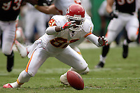 Chiefs punt returner Dante Hall looses the handle on a punt and the Bengals make the recovery in the first quarter at Arrowhead Stadium in Kansas City, Missouri on September 10, 2006. Cincinnati won 23-10.