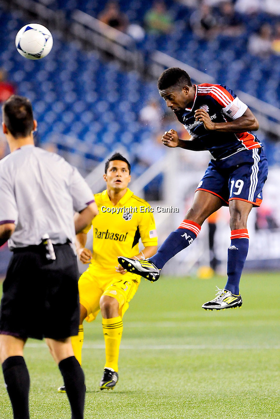 September 5, 2012 New England Revolution midfielder Clyde Simms #19 and Columbus Crew forward Jairo Arrieta #25 in game action during the New England Revolution vs Columbus Crew MLS game held at Gillette Stadium, in Foxborough, Massachusetts.  Eric Canha/CSM