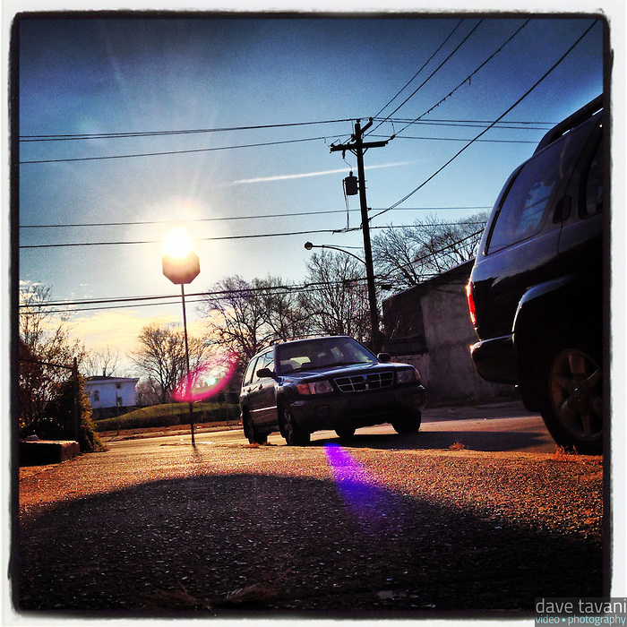 The sun peeks over the top of a stop sign on the corner of Cherokee Street and Washington Lane on December 23, 2012.