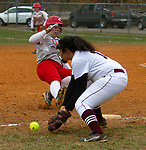 TORRINGTON, CT - 12 APRIL - 041219JW03.jpg -- Wolcott #19 Aly Garofolo slides safely to 3rd as Torrington #18 Madi McLaughlin tries to make the out Friday afternoon at Torrington. Wolcott won 20-2.   Jonathan Wilcox Republican-American