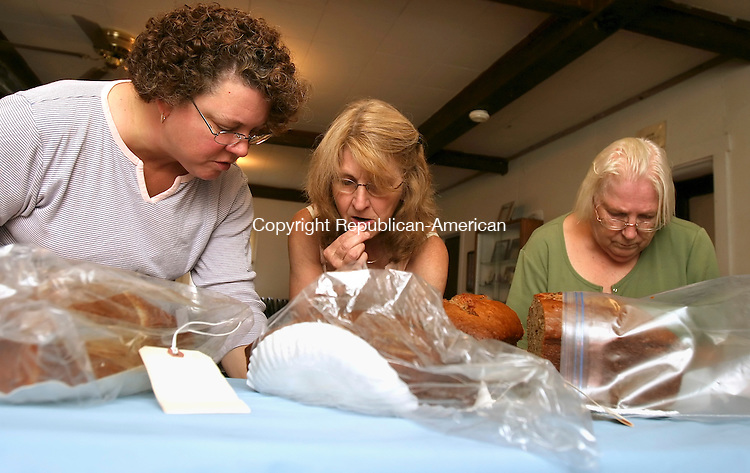 RIVERTON, CT- 06 SEPTEMBER 2008 --090608JS01-Contest judges, from left, Shelley Bailey of Barkhamsted, Gloria Wilber of Colebrook and Dot O'Connor of Winsted, taste banana breads as they judge the Baked Goods division (bread, quick banana) during the 19th annual Riverton Grange Fair at the Riverton Grange Hall on Saturday. The grange is celebrating its 100th year this year. <br /> Jim Shannon / Republican-American