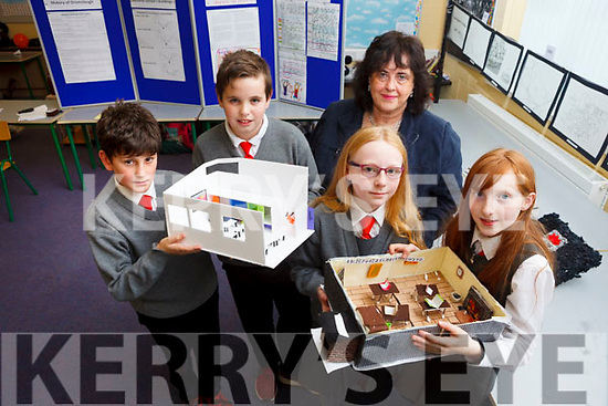 Pupils from fifth class in Dromclough National School designed a new and old school based on the 140 year history of their school. Pictured l-r were: Cian O'Donnell, Tony Dowling, Saoirse White, Méabh Kennelly with principal Mary O'Connor.