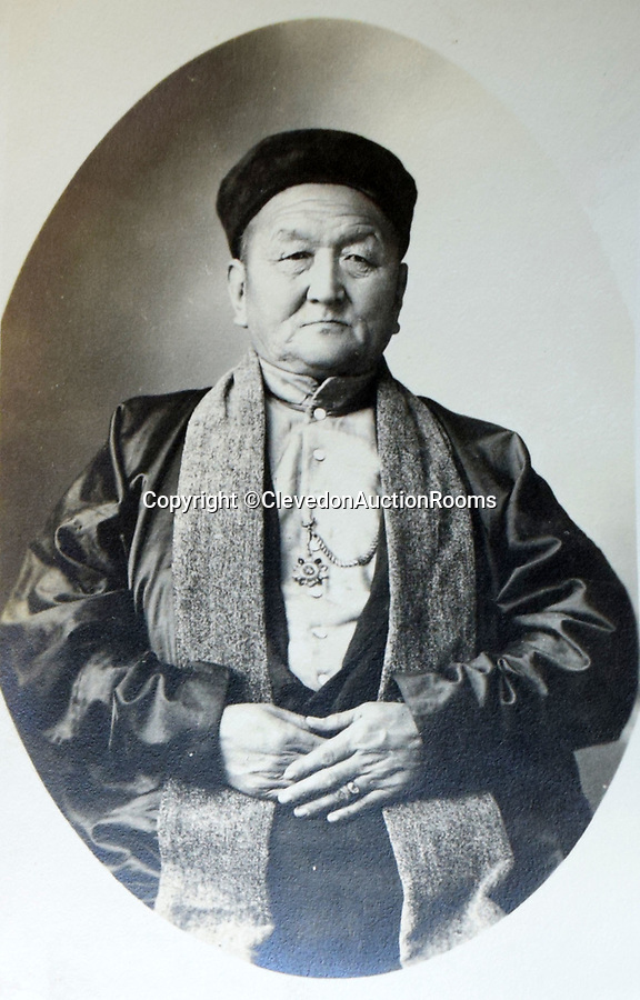 BNPS.co.uk (01202 558833)<br /> Pic: ClevedonAuctionRooms/BNPS<br /> <br /> Local ruler.<br /> <br /> Rev Francis John Griffith travelled as a Missionary aroud Outer Mongolia in the 1920's.<br /> <br /> A fascinating collection of early 20th century photos of Mongolia and China which were taken by a British vicar doing missionary work have been unearthed after 97 years.<br /> <br /> Through his famine relief work Reverend Francis John Griffith was able to get a remarkable insight into the lives of the native population and their nomadic existence.<br /> <br /> His encounters were captured using a handheld camera that he carried with him at all times.<br /> <br /> In one image a family goes about its business outside the hut that is their home, while another image is of a man riding a camel which was the typical method of transport.<br /> <br /> Revd Griffith was able to get native elders to sit for him in portraits and there are intimate snaps of women and children wearing elaborate native headdresses.<br /> <br /> As well as the people, Revd Griffith took an interest in the surroundings and photographed temples and prominent buildings in addition to the vast, desert landscape.