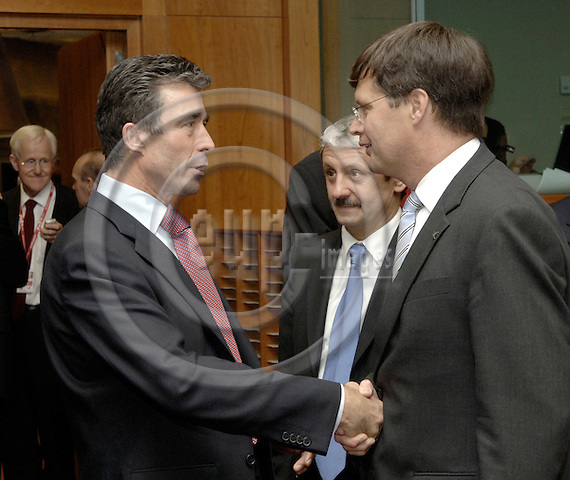 Brussels-Belgium - 15 December 2005---European Heads of State and/or Government meet for a European Council; here, Anders FOGH RASMUSSEN (le), Prime Minister of Denmark, with Jan Peter BALKENENDE (ri), Prime Minister of The Netherlands, Mikulas DZURINDA (ce), Prime Minister of Slovakia, is watching---Photo: Horst Wagner/eup-images