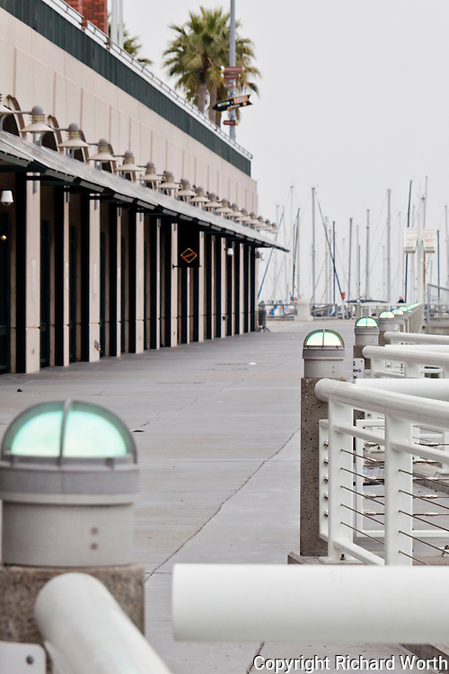 Lighted posts support the zigzag railing along hte walkway, the promenade, on the Mission Bay side of AT&T Park.  San Francisco, CA