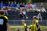 Fans watch the ISPS Handa Premiership Football match between Wellington Phoenix Reserves and Hamilton United at David Farrington Park in Wellington, New Zealand on Saturday, 16 December 2017. Photo: Dave Lintott / lintottphoto.co.nz