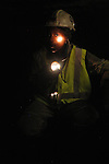 Neo Kgengwe, 24, a mining student at the University of Johannesburg, peers out from the dark in the Total Coal mine near Witbank, where she does practical training during the holidays. Neo already has qualified for her ?blasting ticket,? which theoretically gives her the authority to handle explosives, or in this case supervise the mining with machines, as is the case in modern coal mining.   ..