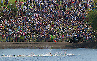 24 JUL 2014 - GLASGOW, GBR - Competitors head for the first turn buoy during the second swim lap at the elite women's 2014 Commonwealth Games triathlon in Strathclyde Country Park in Glasgow, Scotland (PHOTO COPYRIGHT &copy; 2014 NIGEL FARROW, ALL RIGHTS RESERVED)<br /> *******************************<br /> COMMONWEALTH GAMES <br /> FEDERATION USAGE <br /> RULES APPLY<br /> *******************************