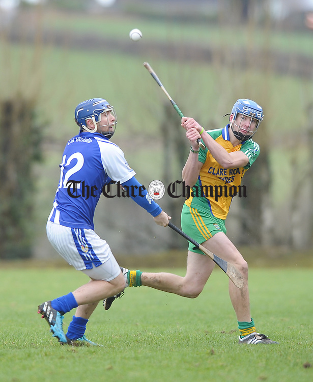 Barry Lynch of Kilmaley in action against Stephen Foudy of Inagh-Kilnamona during their U-21A first round game in Meelick. Photograph by John Kelly.