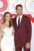 "LOS ANGELES - OCT 30:  Chrishell Stause, Justin Hartley at the ""A Bad Moms Christmas"" Premiere at the Village Theater on October 30, 2017 in Westwood, CA"