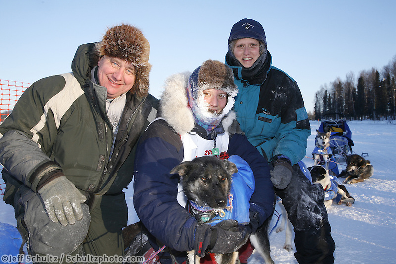 Sunday, February 25th, Willow, Alaska.  Jr. Iditarod musher Melissa Owens poses with her family at the finish line in    Willow