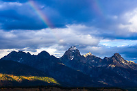 Passing rain showers create double rainbows above the Grand Teton, Teton National Park, Wyoming.