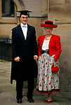 Oxford, Oxfordshire. 1995<br /> A very proud mother poses for a family photograph with her son.  She is  in a brand new flaming red tailored ensemble, no doubt bought especially for the occasion of her son's matriculation ceremony.