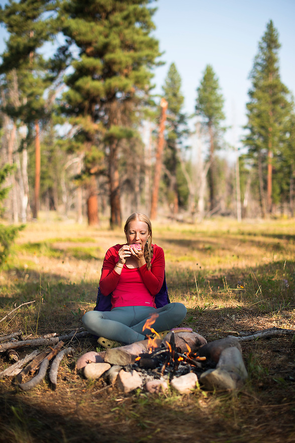 A camper eats breakfast near the South Fork of Flathead River in the Bob Marshall Wilderness.