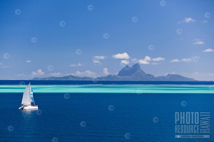Yacht racing in the first leg of the Tahiti Pearl Regatta, from Raiatea to Bora Bora