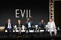 """BEVERLY HILLS - AUGUST 1:  Executive Producers Robert King and Michelle King, Mike Colter, Aasif Mandvi, Michael Emerson onstage during the """"Evil"""" panel at the CBS portion of the Summer 2019 TCA Press Tour at the Beverly Hilton on August 1, 2019 in Los Angeles, California. (Photo by Frank Micelotta/PictureGroup)"""