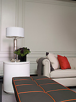 Luxurious soft Bentley leather has been used to upholster both the sofa and the long stool in the suite living room
