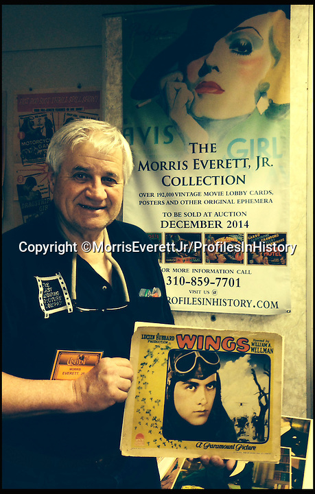 BNPS.co.uk (01202 558833)<br /> PIc: MorrisEverettJr/ProfilesInHistory/BNPS<br /> <br /> ***Please Use Full Byline***<br /> <br /> Morris Everett Jr with some of his movie posters. <br /> <br /> The world's largest collection of movie posters boasting artwork from almost every single film made in the last century has emerged for sale for &pound;5 million.<br /> <br /> The colossal archive features 196,000 posters from more than 44,000 films, and has been singlehandedly pieced together by one avid collector over the last 50 years.<br /> <br /> Morris Everett Jr has dedicated his life's work to seeking out original posters from every English-speaking film ever made and compiling them into a comprehensive library.<br /> <br /> The sale is tipped to make $8 million - around &pound;5 million pounds - when it goes under the hammer in one lot at Califonia saleroom Profiles in History on December 17.