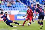 Sami Mohamed Alhusaini of Bahrain (R0 fights for the ball with Mika Chunuonsee of Thailand (L) during the AFC Asian Cup UAE 2019 Group A match between Bahrain (BHR) and Thailand (THA) at Al Maktoum Stadium on 10 January 2019 in Dubai, United Arab Emirates. Photo by Marcio Rodrigo Machado / Power Sport Images