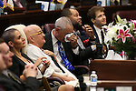 Greg Smith wipes away tears as his wife, Nevada Sen. Debbie Smith, D-Sparks, is recognized on the Senate floor at the Legislative Building in Carson City, Nev., on Wednesday, April 8, 2015. Smith returned to work Wednesday, two months after having a malignant brain tumor removed. <br /> Photo by Cathleen Allison
